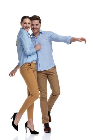 Foto de in love casual couple wants to fly on white background - Imagen libre de derechos