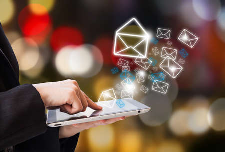Foto de Business woman is checking email by digital tablet - Imagen libre de derechos