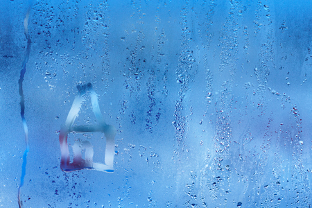 Photo for Hand draw on glass and water drop. Condensation and raindrops on a window, shallow depth of field. - Royalty Free Image