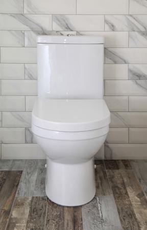 Foto de White toilet bowl in modern bathroom, selective focus - Imagen libre de derechos