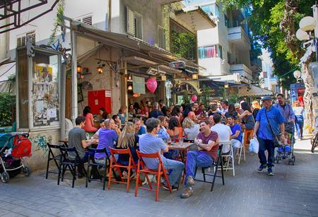 TEL AVIV, ISRAEL - APRIL 1, 2016: People in outdoor cafe on Dizengoff Street in Tel Aviv, Israel.