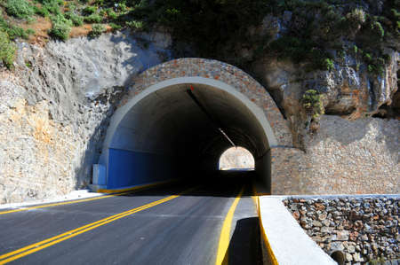 Mountain road passing through a tunnel in the island of