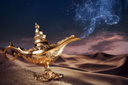 Photo pour Aladdin magic lamp on a desert with smoke - image libre de droit