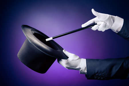 Foto de Magician hand with magic wand and hat - Imagen libre de derechos
