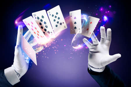 Photo pour Magician hands with magic cards - image libre de droit