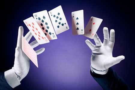 Photo pour Magician hands with magic cards - image libre de droit