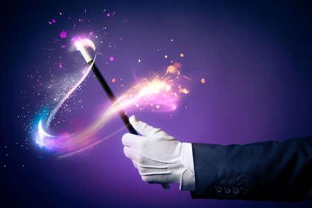Photo pour Magician hand with magic wand - image libre de droit