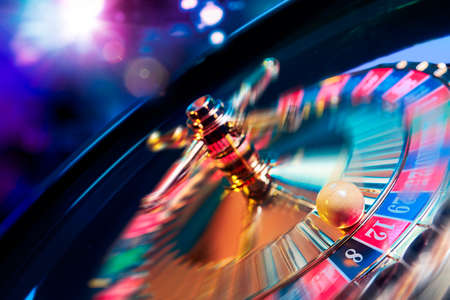 Photo for high contrast image of casino roulette in motion - Royalty Free Image