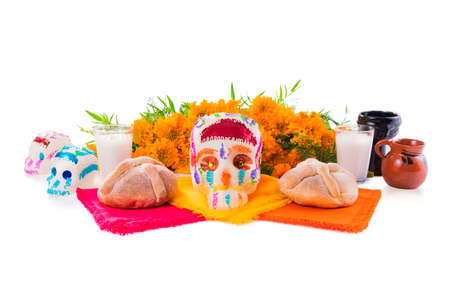 Photo for sugar skull used for dia de los muertos celebration isolated on white with cempasuchil flowers - Royalty Free Image