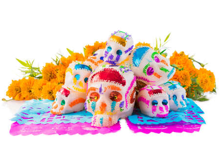 Photo for sugar skulls used for dia de los muertos celebration isolated on white with cempasuchil flowers - Royalty Free Image