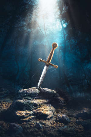 Photo for High contrast image of Excalibur, sword in the stone with light rays and dust specs in a dark forest - Royalty Free Image