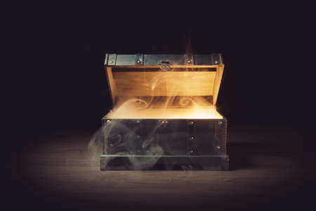 Photo pour pandoras box with smoke on a wooden background - image libre de droit
