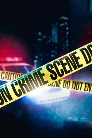 Foto de police car at a crime scene with police tape, high contrast image - Imagen libre de derechos