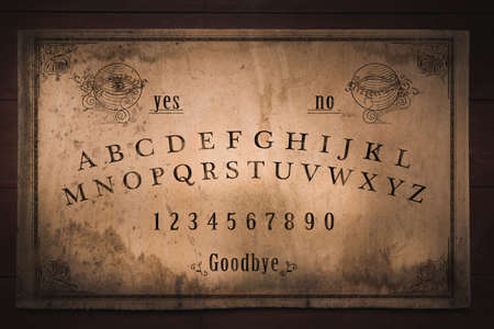 Photo for Talking board and planchette used on seances for communicating with the dead, high contrast image - Royalty Free Image
