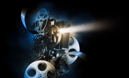 Photo for Cinema background with movie projector and film reels on a dark background / high contrast image - Royalty Free Image