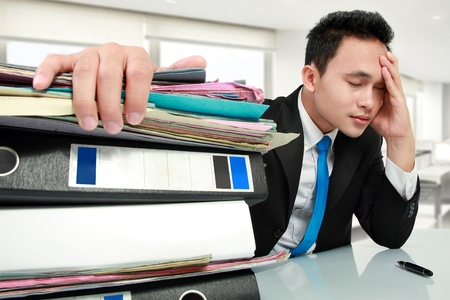 Portrait of busy businessman stressed at work