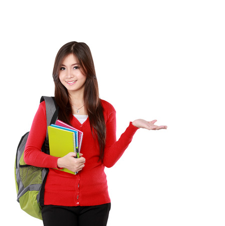 Foto de female student in red cardigan presenting blank area copy space - isolated on white background. - Imagen libre de derechos