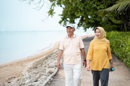 Photo pour senior asian couple walking and exercising - image libre de droit
