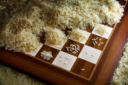 Photo for chessboard with exponential growing heaps of rice grains, legendary metaphor of unlimited growth - Royalty Free Image