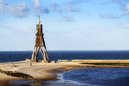 Foto de Kugelbake, old sea sign and landmark against the blue sky, symbol of the town Cuxhaven on the North Sea in Germany,  popular tourist destination and holiday resort, copy space - Imagen libre de derechos