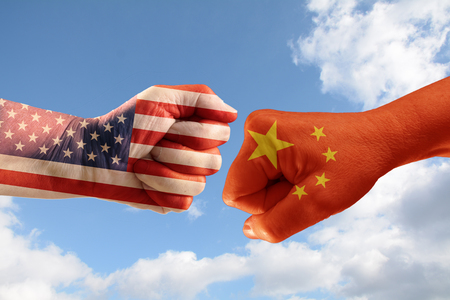 Photo for Trade conflict, fists with the flags of USA and China against each other, blue sky with clouds in the background - Royalty Free Image