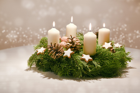 Photo for Fourth  Advent - decorated Advent wreath from fir and evergreen branches with white burning candles - Royalty Free Image