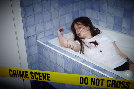 Photo for young woman lying dead in a bath tub - Royalty Free Image