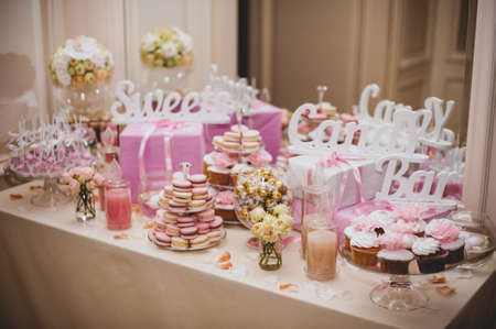 Photo for party reception, decorated desert table pink color - Royalty Free Image