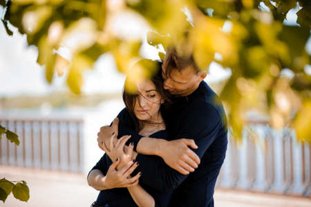 Photo for Man in love comforting his smiling woman outdoor - Royalty Free Image