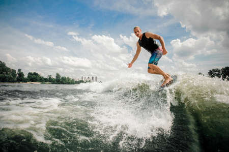 Foto de Practised athletic rider moves outside of the wake and cuts rapidly in toward the wake - Imagen libre de derechos