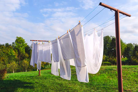 Photo for fresh clean white sheet drying on washing line in outdoor - Royalty Free Image