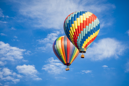 Photo for Beautiful Hot Air Balloons Against a Deep Blue Sky and Clouds. - Royalty Free Image