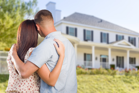 Photo for Affectionate Military Couple Looking at Nice New House. - Royalty Free Image