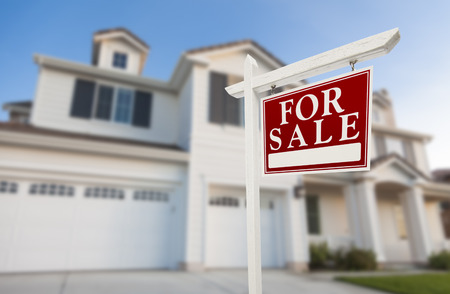 Photo for Home For Sale Real Estate Sign in Front of Beautiful New House. - Royalty Free Image