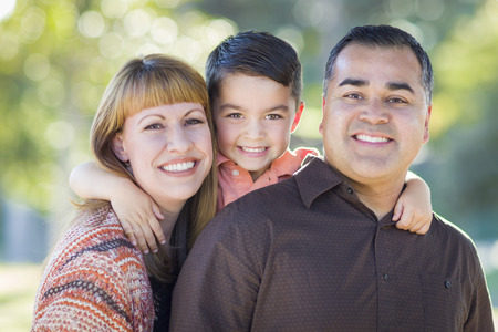 Foto de Happy Attractive Young Mixed Race Family Portrait Outdoors. - Imagen libre de derechos