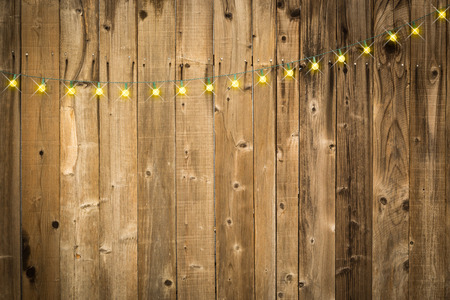 Photo for Lustrous Wooden Background with Bright String of Lights. - Royalty Free Image