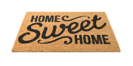 Photo for Home Sweet Home Welcome Mat Isolated on a White Background. - Royalty Free Image