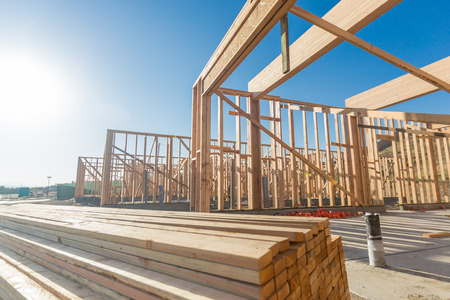 Foto per Wood Home Framing Abstract At Construction Site. - Immagine Royalty Free