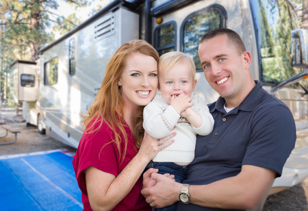 Photo for Happy Young Military Family In Front of Their Beautiful RV At The Campground. - Royalty Free Image
