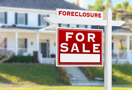 Photo for Left Facing Foreclosure For Sale Real Estate Sign in Front of House. - Royalty Free Image