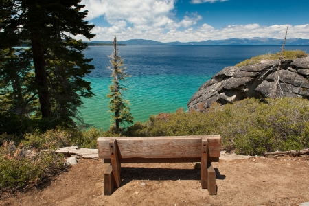 Old wooden bench looks over Lake Tahoe