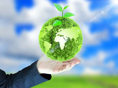 Photo for green globe in hand - Royalty Free Image