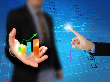Photo pour Businessman holding business graph  - image libre de droit
