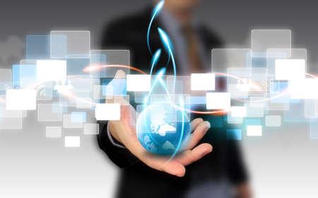 Photo pour businessman holding business world  - image libre de droit