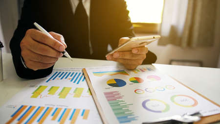 Photo for Businessman working in the office. business report graphs - Royalty Free Image