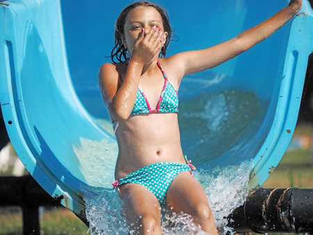 Photo for Little girl playing in a water park - Royalty Free Image