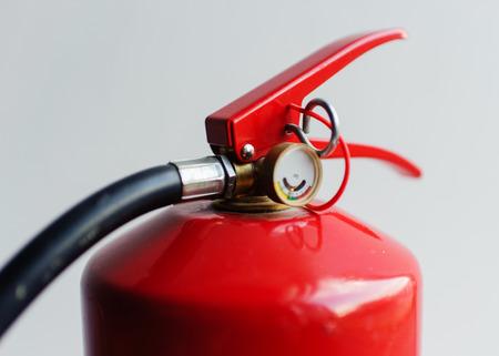 Foto de red fire extinguisher on white background - Imagen libre de derechos
