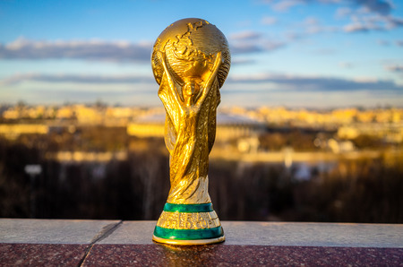 Foto für April 13, 2018 Moscow, Russia Trophy of the FIFA World Cup against the backdrop of the Luzhniki stadium in Moscow. - Lizenzfreies Bild