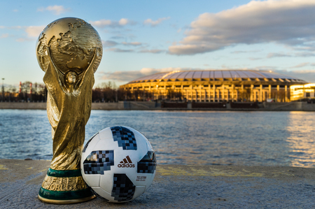 Foto für April 13, 2018 Moscow, Russia Trophy of the FIFA World Cup and official ball of FIFA World Cup 2018 Adidas Telstar 18  against the backdrop of the Luzhniki stadium in Moscow. - Lizenzfreies Bild