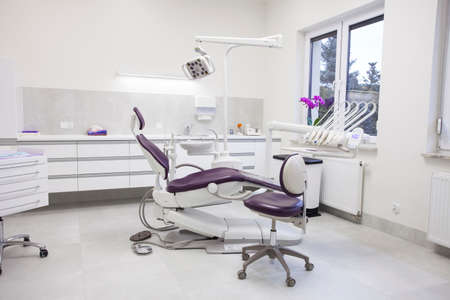 Photo for Modern dental practice. Dental chair and other accessories used by dentists. - Royalty Free Image